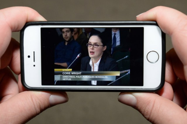 A viewer watches Netflix global public policy director Corie Wright testify before the Canadian Radio-television and Telecommunications Commission (CRTC) in Ottawa (Image: Sean Kilpatrick, The Canadian Press)