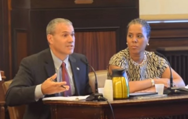 Kevin Service (L), vice president, region operations - New York City and Leecia Eve, vice president of government affairs - New York, New Jersey, and Connecticut testify before the City Council of New York.